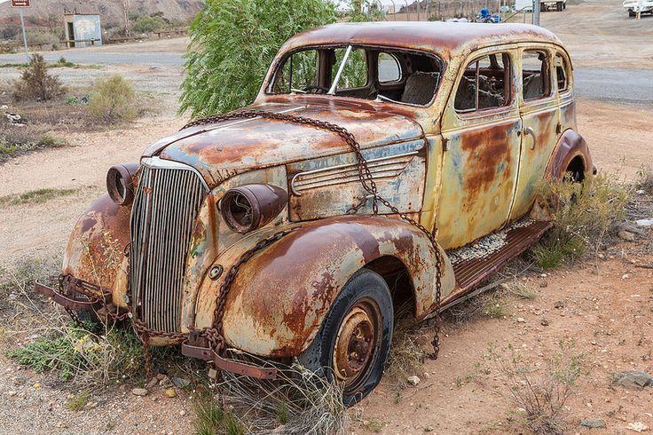 old vehicle - rusty vehicle - chained vehicle
