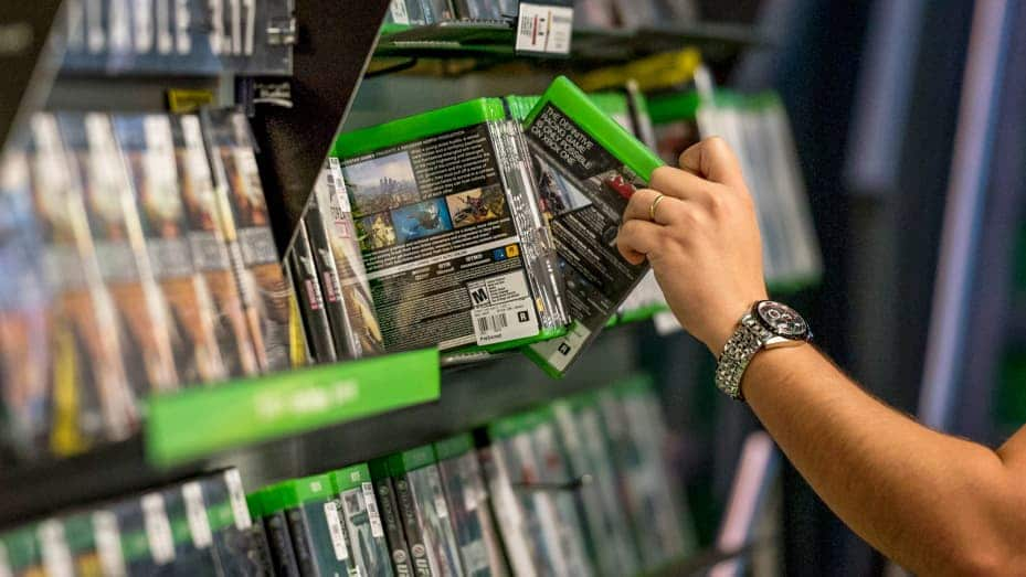 gamestop - video game shelf - xbox games - buying games - game store